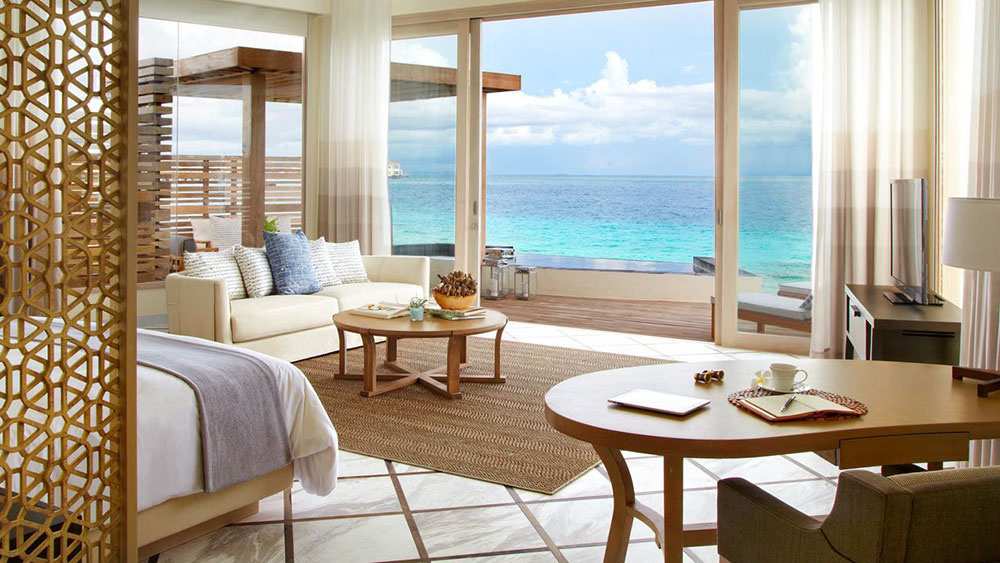 Beach House Interior Design Ideas the living room is pretty but not too stuffy i think thats essential in a beach house notice the views Beach House Interior And Exterior Design Ideas To