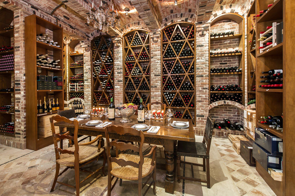 Wine Cellar Design Ideas brick wall home wine cellar design ideas with horizontal hanging wine bottles on iron hooks Wine Cellar Design Ideas 10 Wine Cellar Design Ideas